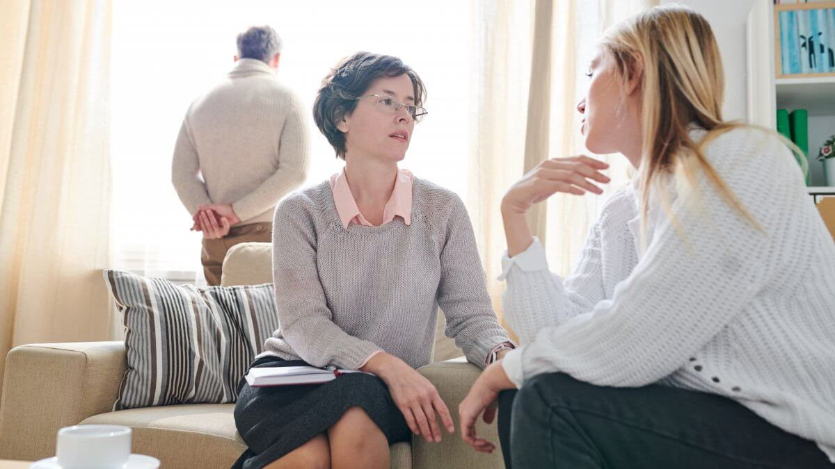 psychologist listening to woman with anxiety